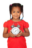 African little girl with a silvered clock Royalty Free Stock Photos