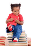 African little girl sitting on many books Stock Image