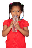 African little girl with water bottle Royalty Free Stock Photography