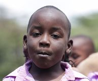 African school child boy portrait. African little school children boys and girls play on the street in the small village school outside stock photos