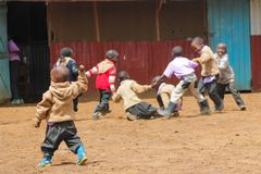 African little school children fighting. African little school children boys and girls play on the street in the small village school outside stock photos
