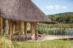 African lodge by lake Stock Photos