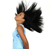 African long hair beauty. Portrait of young african american girl waving her hair - isolated Royalty Free Stock Photos