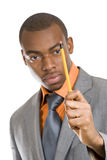 African maerican business man holding a pencil Stock Images