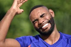 African Male Athlete Laughing. A handsome adult black man Royalty Free Stock Image