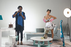 African Male Boss and Sexy Housekeeper. African DJ Jesus and beautiful singer Kataleya were in studio recording a video for one of the themes from the musician Stock Photography