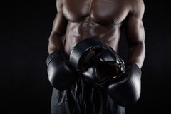 African male boxer relaxing after workout Stock Image