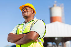 African male constructor. Happy african male constructor with arms folded Royalty Free Stock Photo