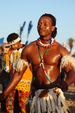 African male dancer, IMSA 2011. A black male dancer as part of a traditional African entertainment dance group at the International sports event Ironman South stock image
