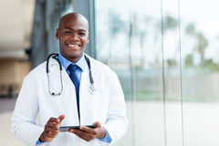 African male doctor. Happy african male doctor with tablet computer Royalty Free Stock Image