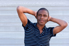African male fashion model in striped shirt Royalty Free Stock Image