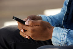 African male hands holding mobile phone. Close up portrait of african male hands holding mobile phone Stock Images