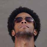 African male head. Portrait of young handsome african male with sunglasses Stock Photography