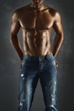 African male model wearing jeans. royalty free stock images