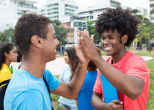 African male student give high five to indian student Royalty Free Stock Photography