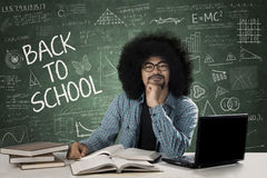 African male student studying in class. African man student sitting in the classroom while studying and thinking idea with text of Back to School on the Stock Photography