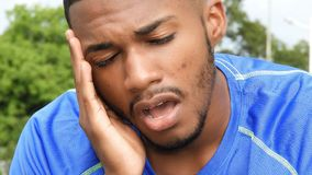 African Male Tired Athlete. A handsome adult black man Stock Photo
