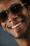 African male with toothy smile. Portrait of young african american man with beautiful smile Royalty Free Stock Photo