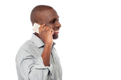 African male using is cell phone. Happy middle aged man calling with mobile phone Stock Photography