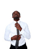 African man adjusting his necktie. Over white background Royalty Free Stock Photos