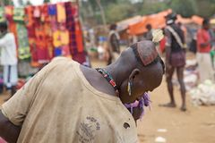 African man hair style. African man of the Banna ethnic group withh traditional ornaments has tribal hair style with feather that mean He is a very strong man royalty free stock images
