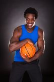 African Man With Basketball Royalty Free Stock Photos
