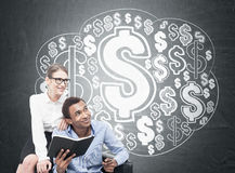 African man and blond woman, dollar cloud Royalty Free Stock Photo