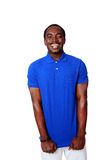 african man in blue t-shirt standing Stock Photo