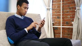 African Man Browsing Online on Smartphone, Using Internet. 4k , high quality stock footage
