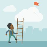 African man with career ladder Stock Image