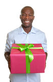 African man with a christmas present in his hands Royalty Free Stock Photo
