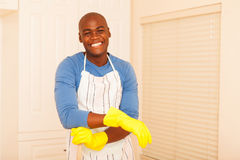 African man cleaning bedroom Stock Images
