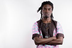 Black man with dreadlocks in traditional colorful cloth. African man with dreadlocks in traditional colorful cloth royalty free stock photography