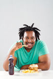 African man eating chips Royalty Free Stock Photography