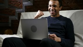 African Man Excited for Successful Online Shopping. 4k , high quality stock image
