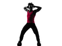 African man exercising fitness zumba dancing silhouette Stock Photo