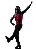 African man exercising fitness zumba dancing silhouette Stock Photos