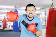 African man fighting in the gym center Royalty Free Stock Image