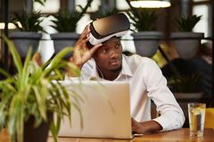 African man in glasses of virtual reality on head. Stock Image