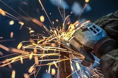 African man grinding metal. Sparks from an African man grinding metal Royalty Free Stock Photos