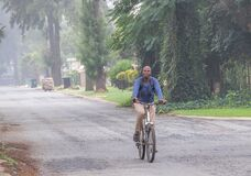 African man on his way to work by bicycle