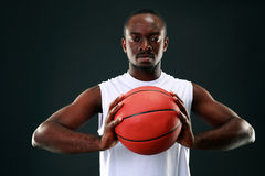 African man holding basketball ball Stock Image