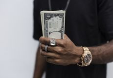 African man holding cash on his hand Royalty Free Stock Photography