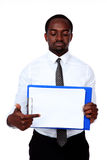 African man holding folder. And showing on blank document Stock Photo