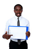 African man holding folder. And showing on blank document Royalty Free Stock Image