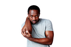 African man holding his elbow Royalty Free Stock Photography