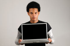 African man holding laptop computer Royalty Free Stock Photos