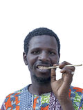 African man holding a miswak (teeth cleaning twig), isolated Stock Images