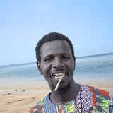African man holding a miswak (traditional teeth cleaning twig) Royalty Free Stock Photos