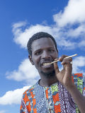 African man holding a miswak (traditional teeth cleaning twig) Royalty Free Stock Photo